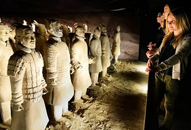 Tourists are visiting Terracotta Warriors and Horses.