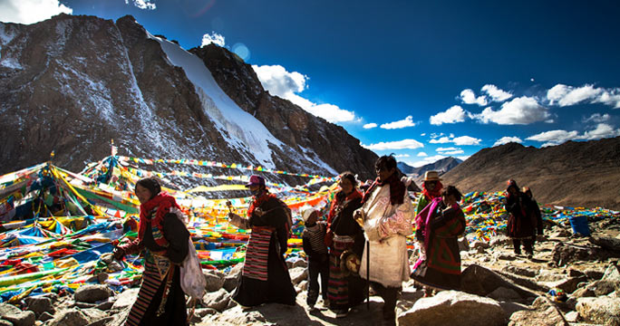 well-dressed Tibetan pilgrims are circling sacred Mount Kailash.