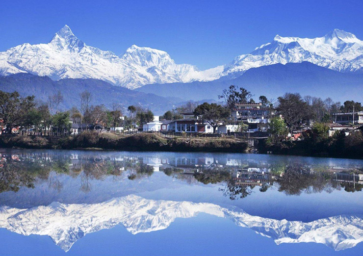 Annapurna and its reflection in Phewa Lake