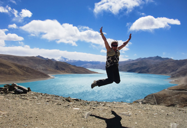 Excited tourist beside Yamdrok Lake