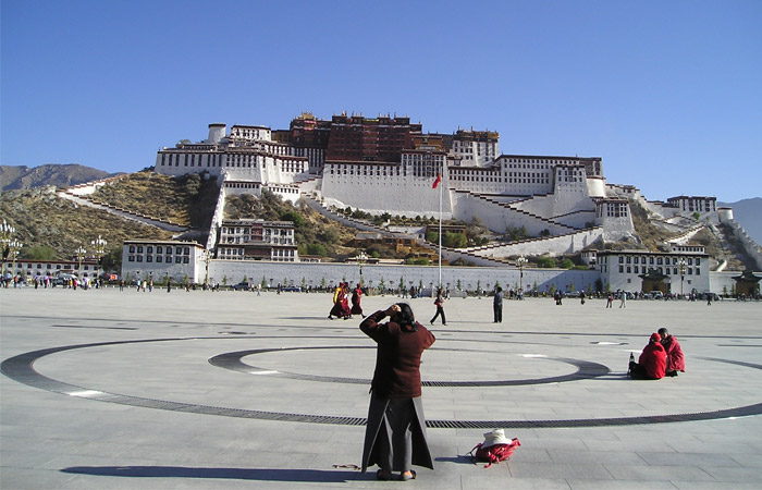 A local pilgrim at the square in front of the Potala Palace