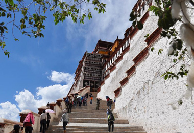 Tourists take photos as they climb Potala Palace