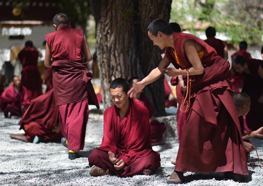 Monks debate with each other in debating courtyard of Sera Monastery.